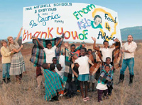 African children from Ingwavuma present the DeJorias with a banner of thanks.