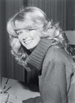 Farrah Fawcett's iconic feathered hairstyle
