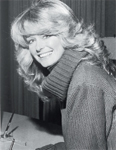Use your blow-dryer to create an updated version of Farrah Fawcett's iconic hairstyle, in again for fall.