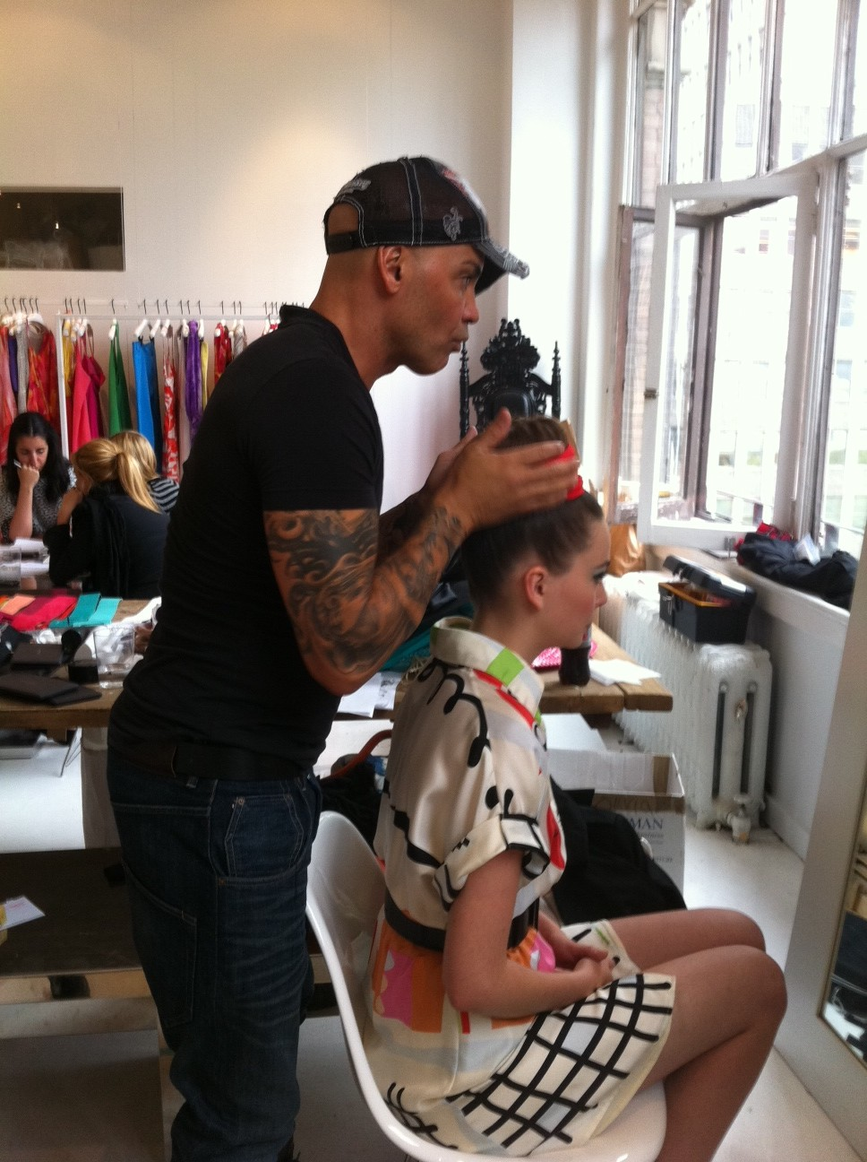 Sebastian Professional hairstylist Anthony Cole perfects a look backstage at the Alice + Olivia spring 2012 look book shoot.