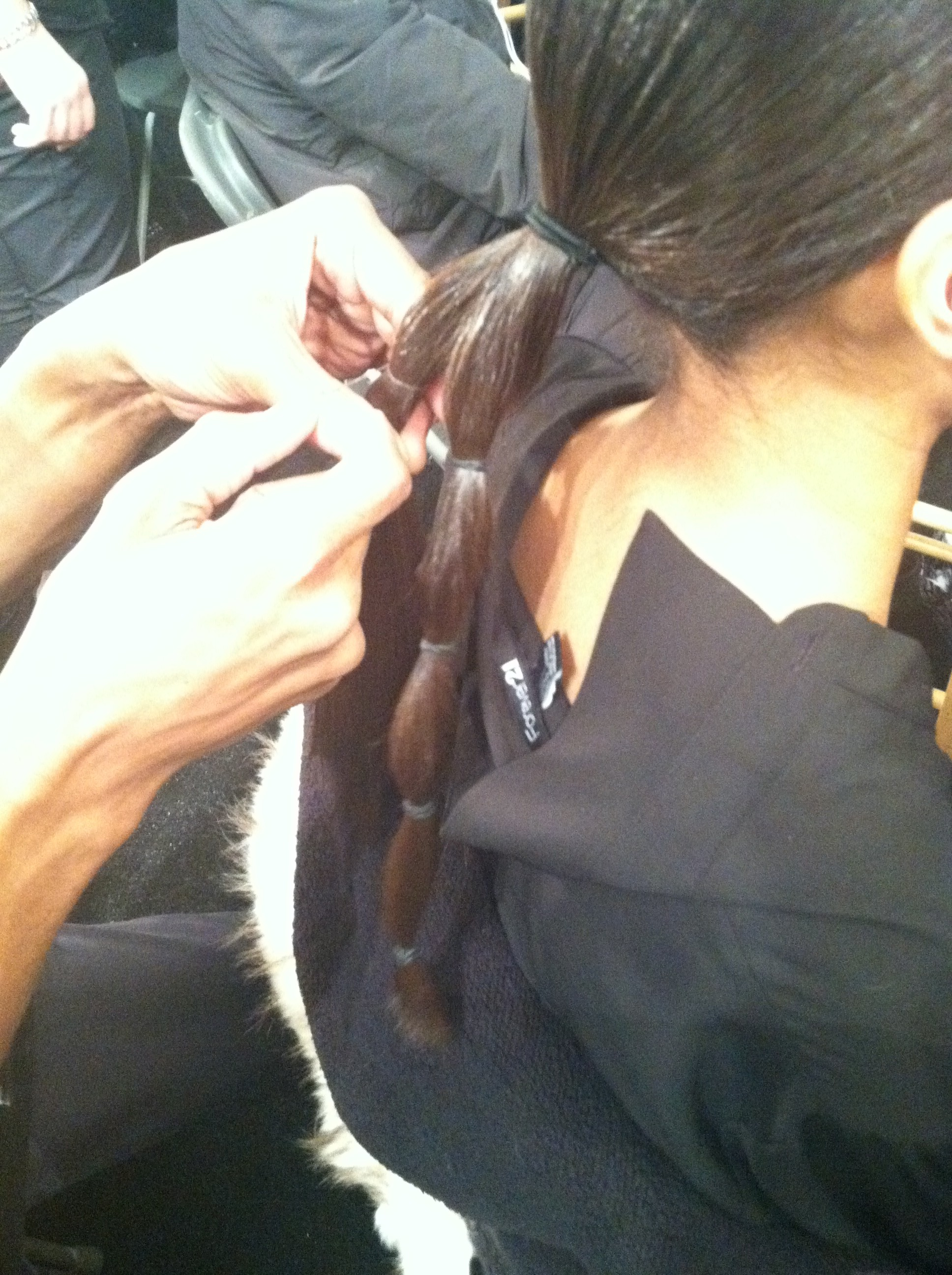 The low ponytail is sectioned into honeycombs with elastics