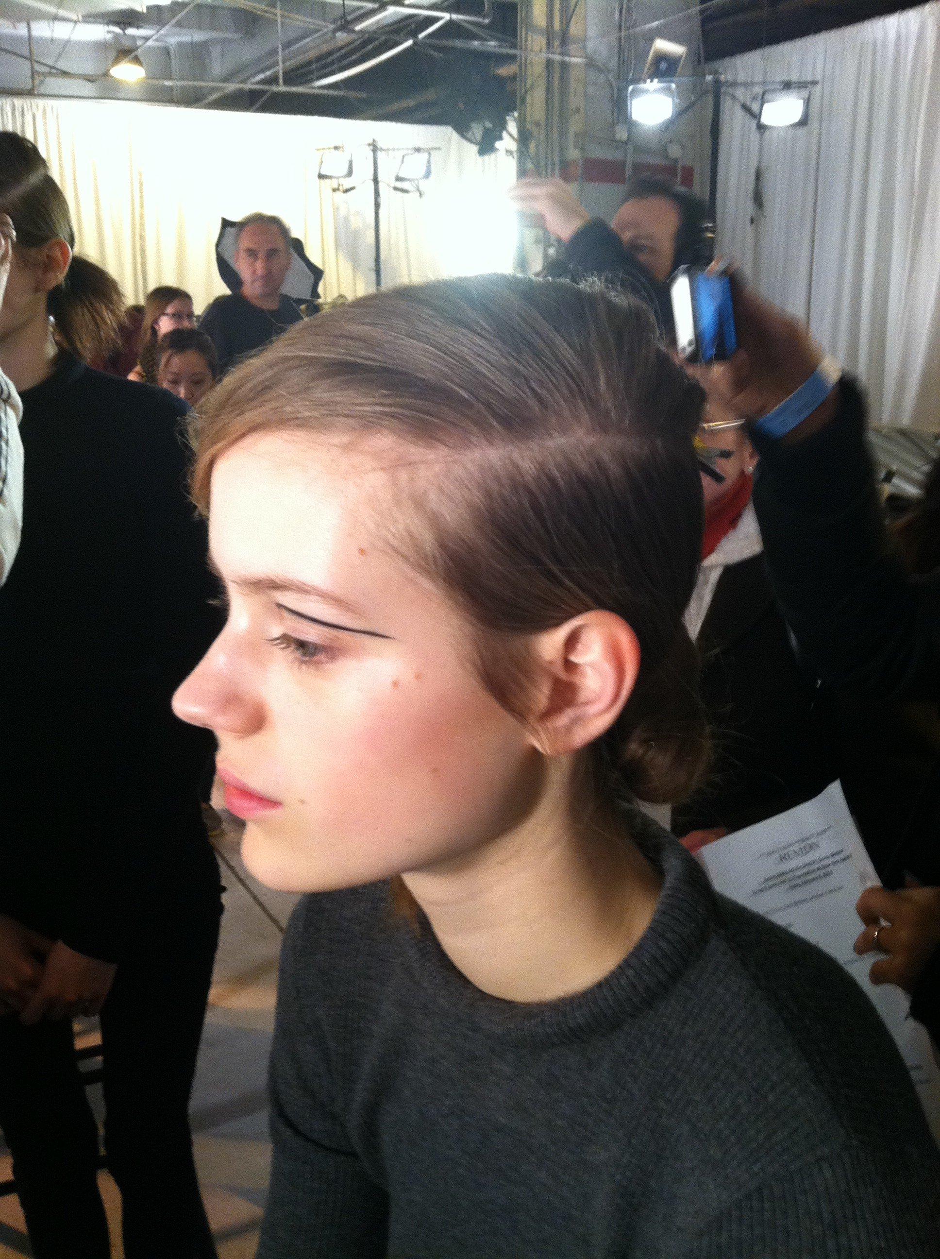 A deep side part and graphic eye liner.