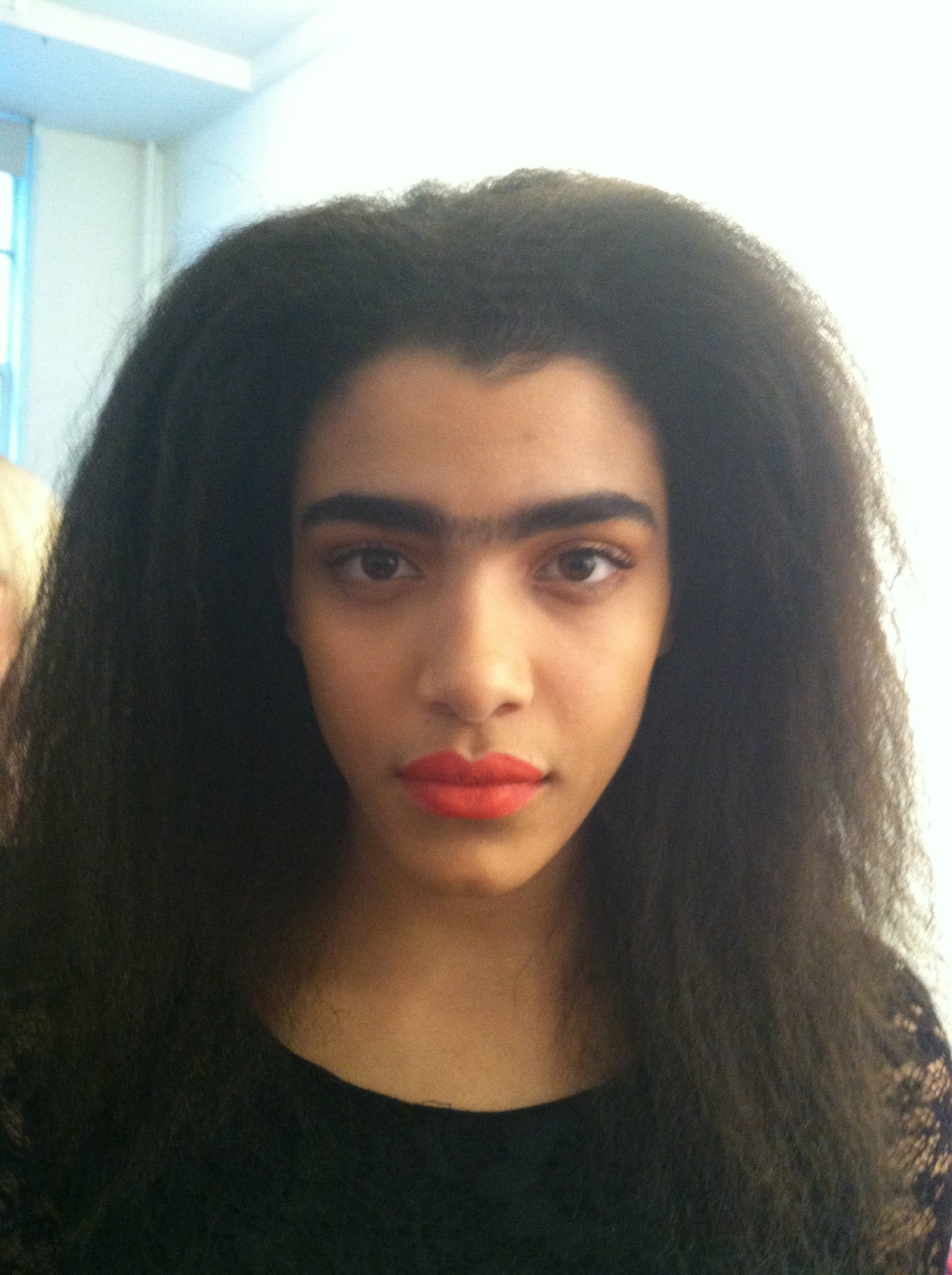 Finished makeup with Frida-meets-Brook Shields-brow