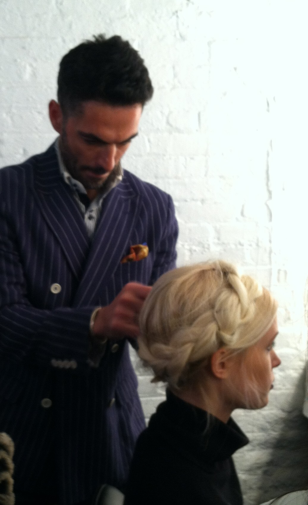 A braided extension is fastenednear the natural hair braids