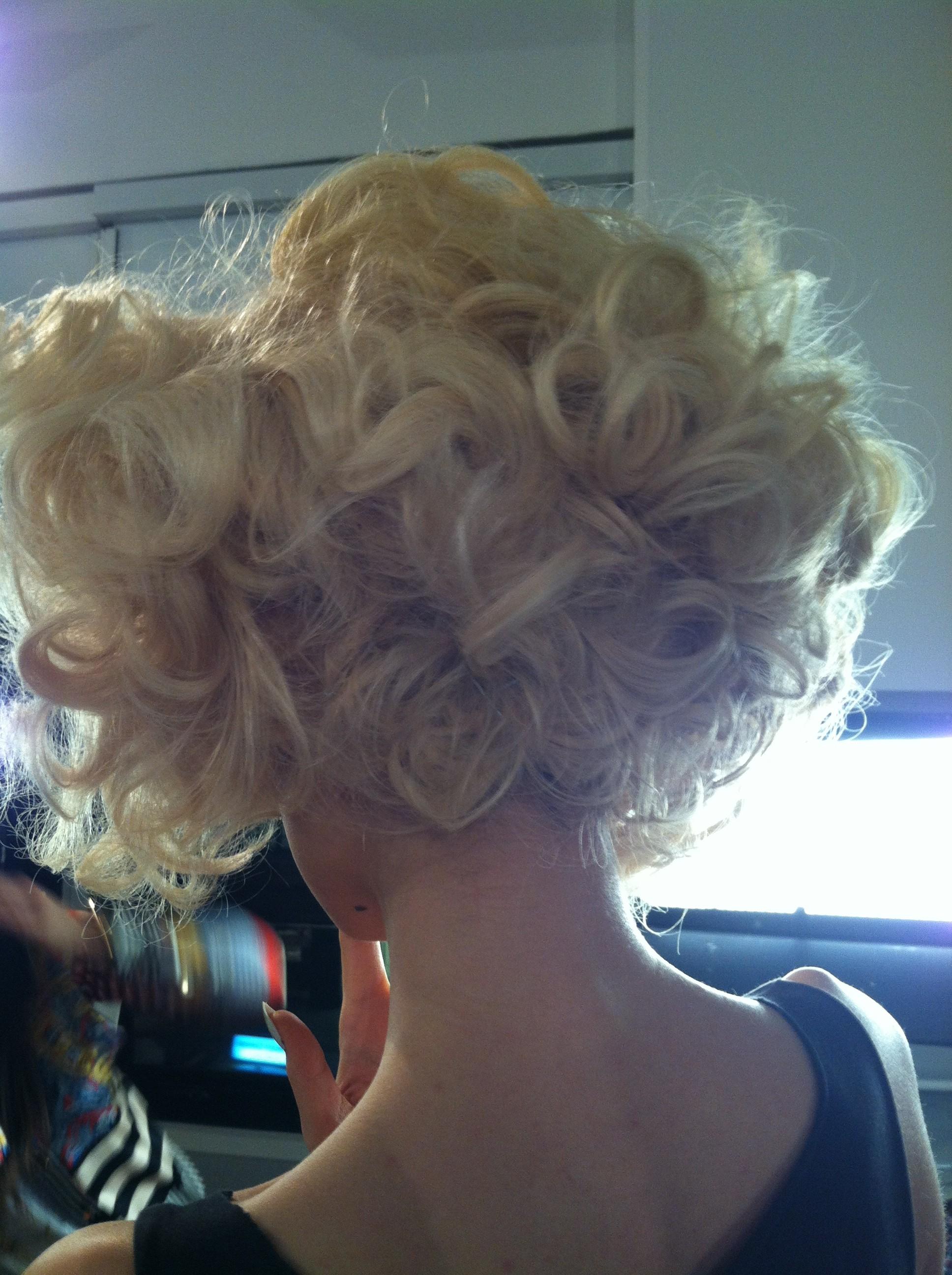A disheveled curly back