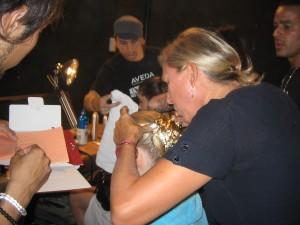 Odile applying gold foil to a model's hair at Rodarte