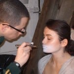 OCC's David Klasfeld applying airbrush makeup