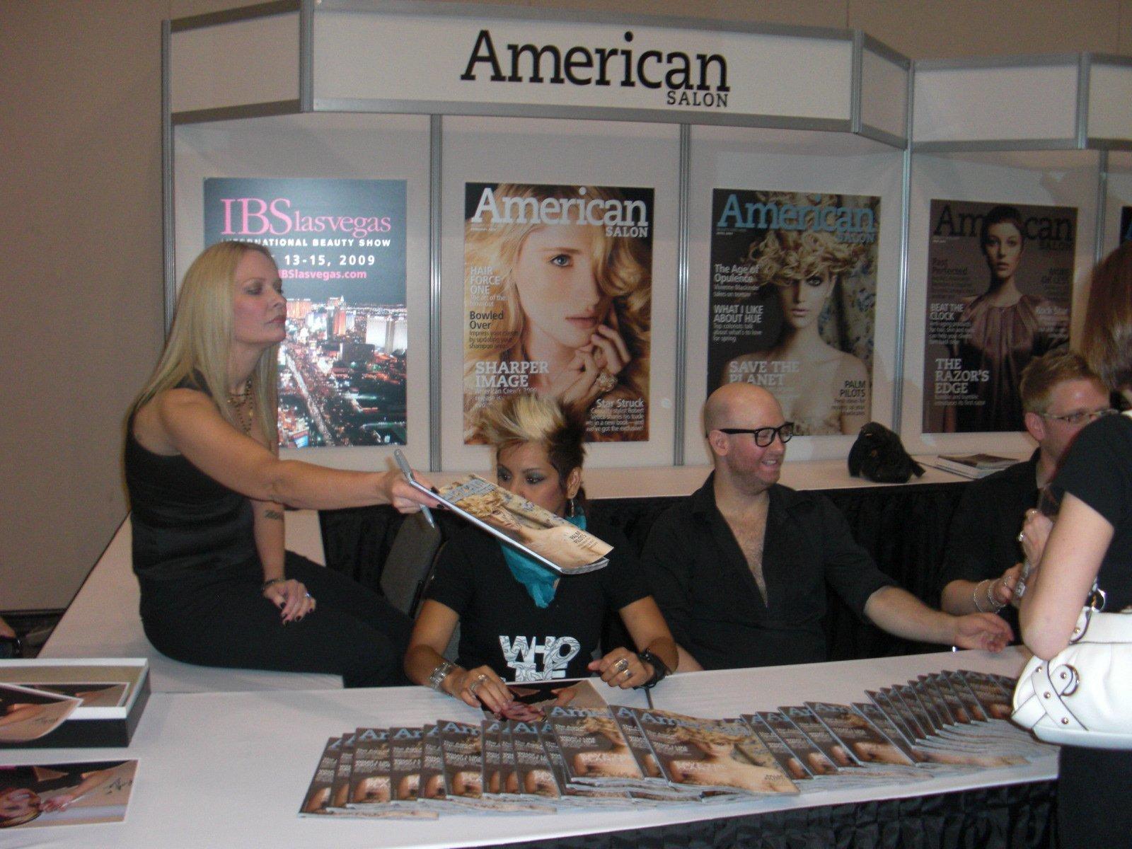 Glenn, Dee and Charlie sign autographs