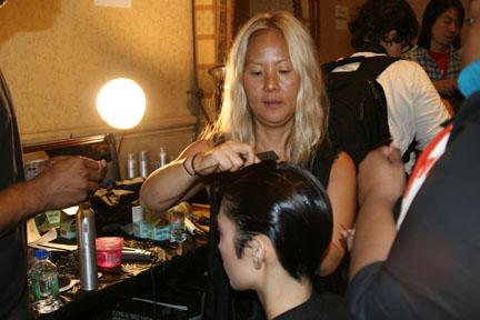 Bok-Hee styling a model backstage