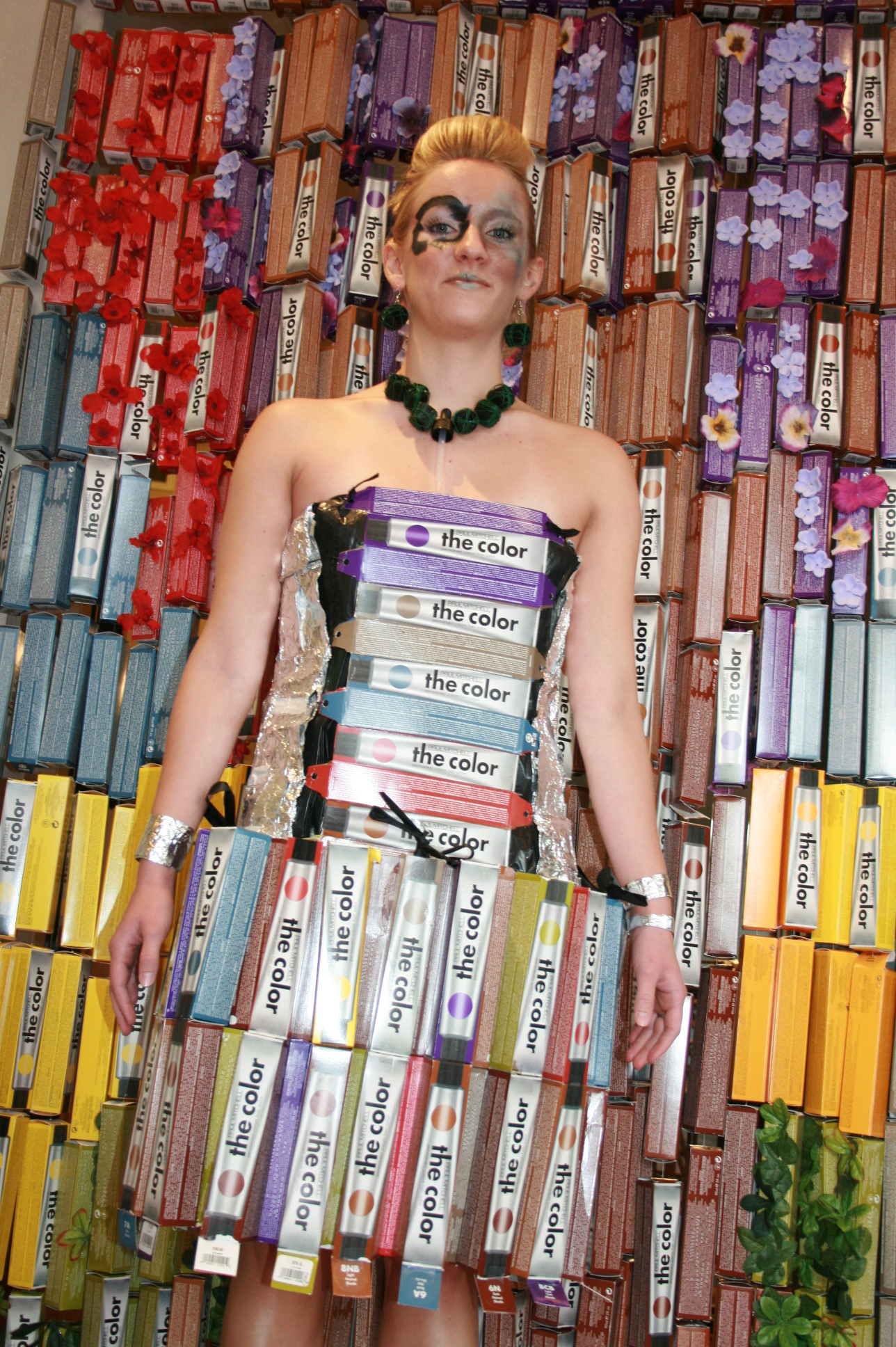 Splish staffer Kristin McSherry goes eco-chic in a dress made from recycled foils and Paul Mitchell color boxes and a necklace created from the tops of color tubes.