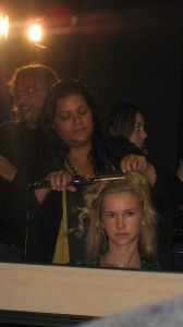 Amy Farid uses a marcel curling iron to create natural looking waves.