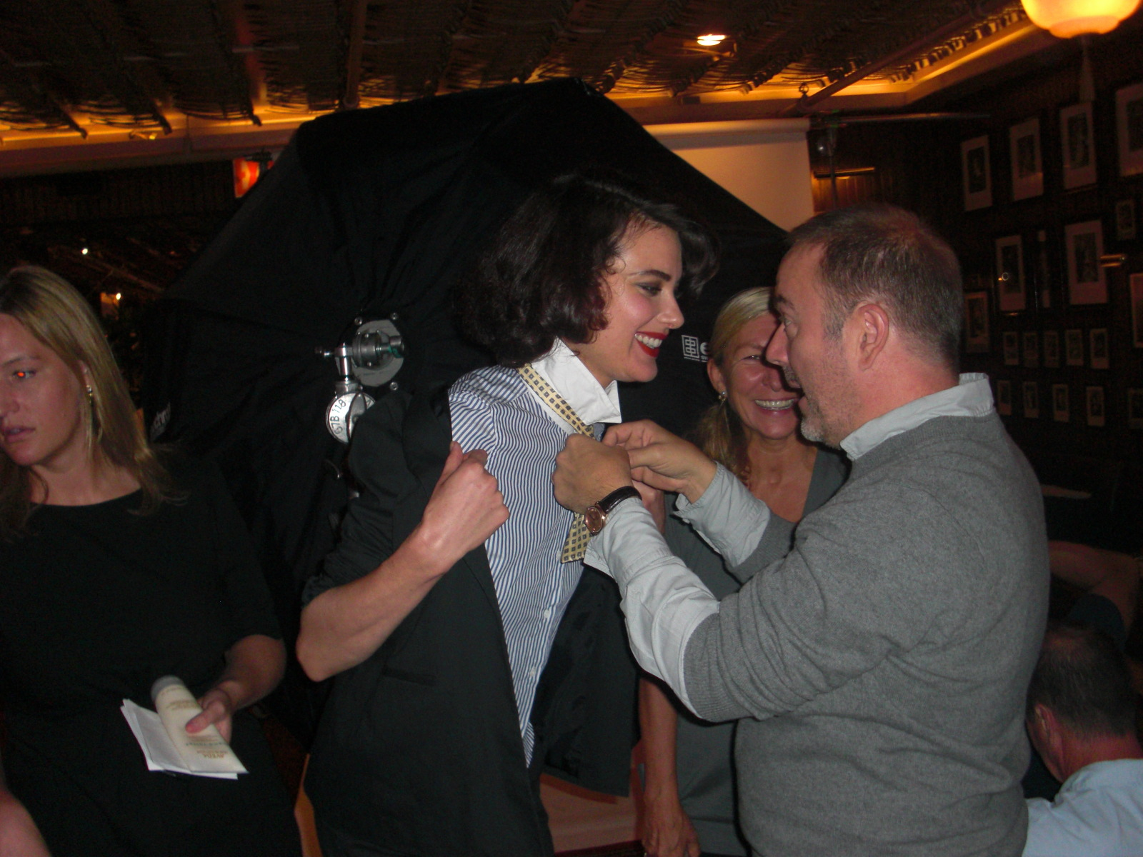 John Patrick gets supermodel Shalom Harlow ready to act as bartender for the event