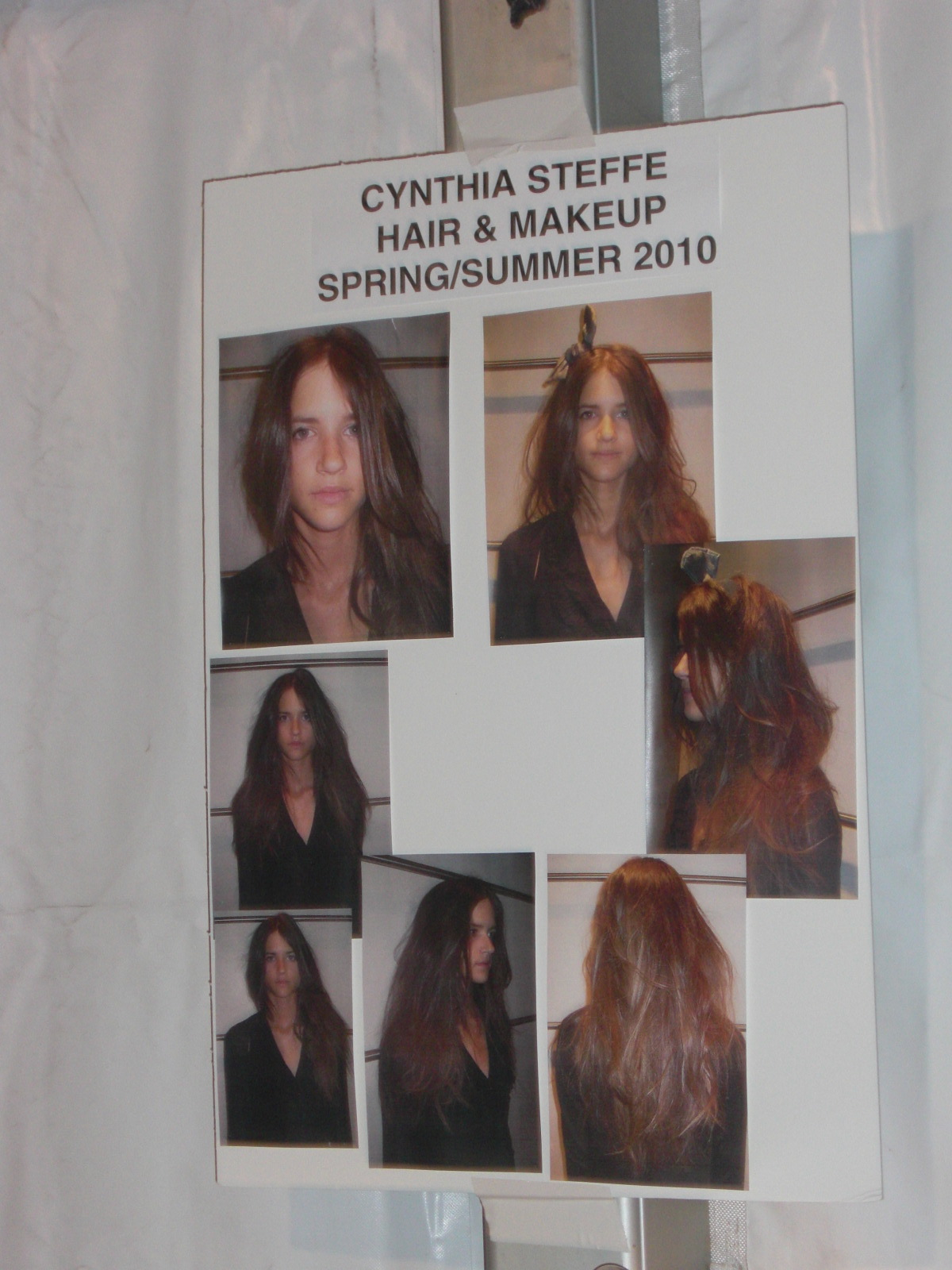 The board showing what the hair and makeup should look like