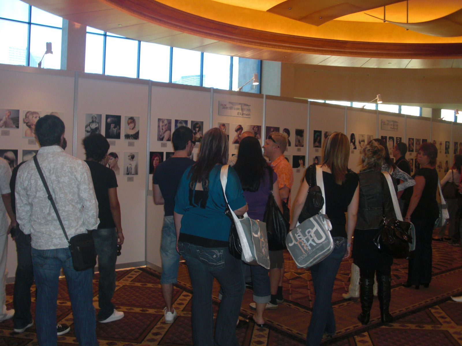 Observers checking out the photo entries from the finalists
