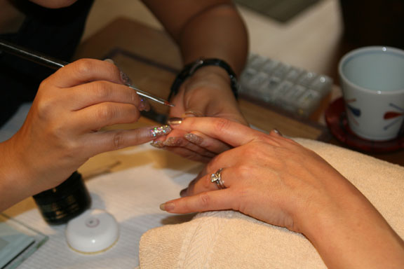 Two coats of the color Calgel are then applied to the nail.