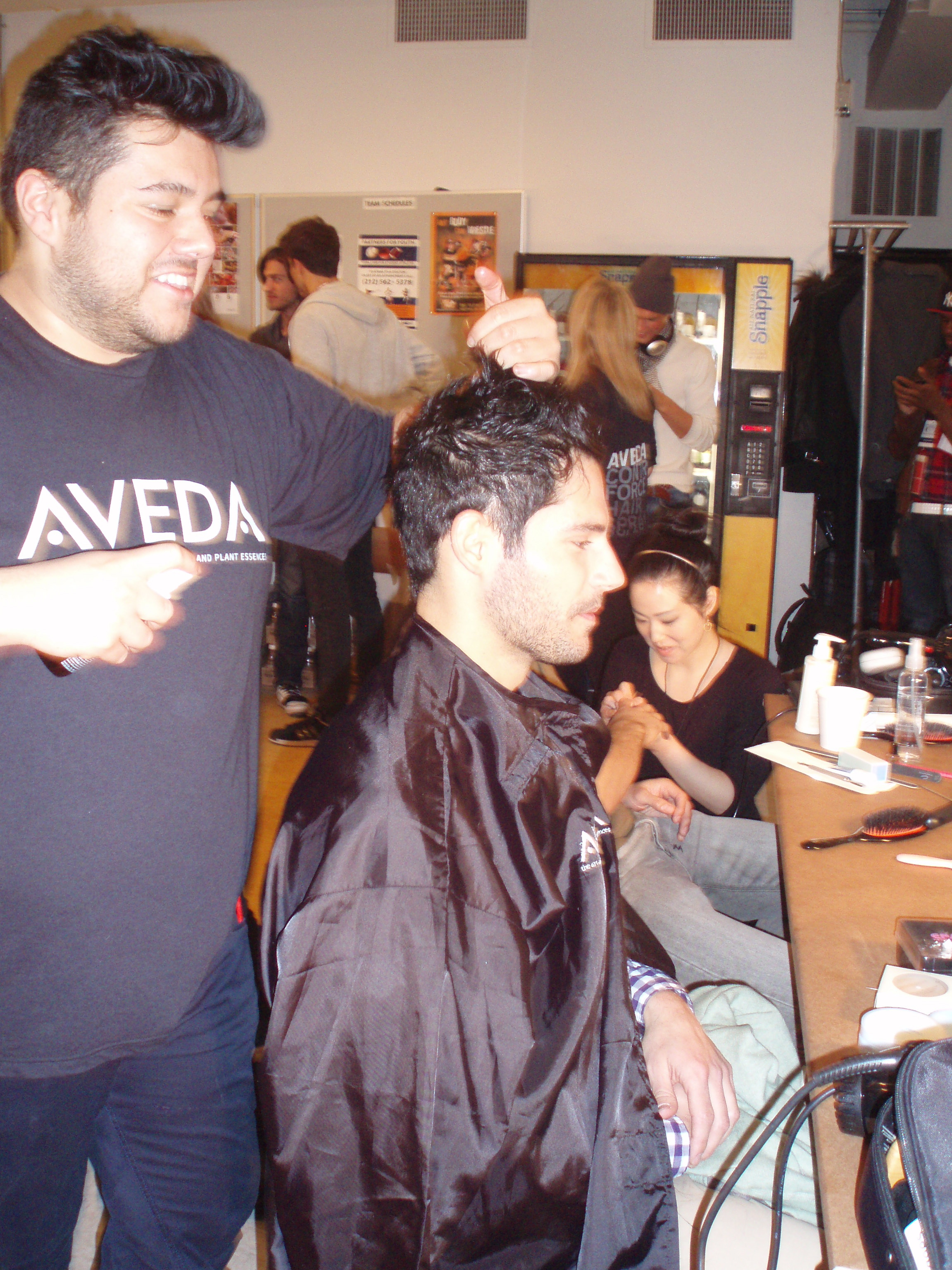 An Aveda stylist crafts a rugged and textured look.