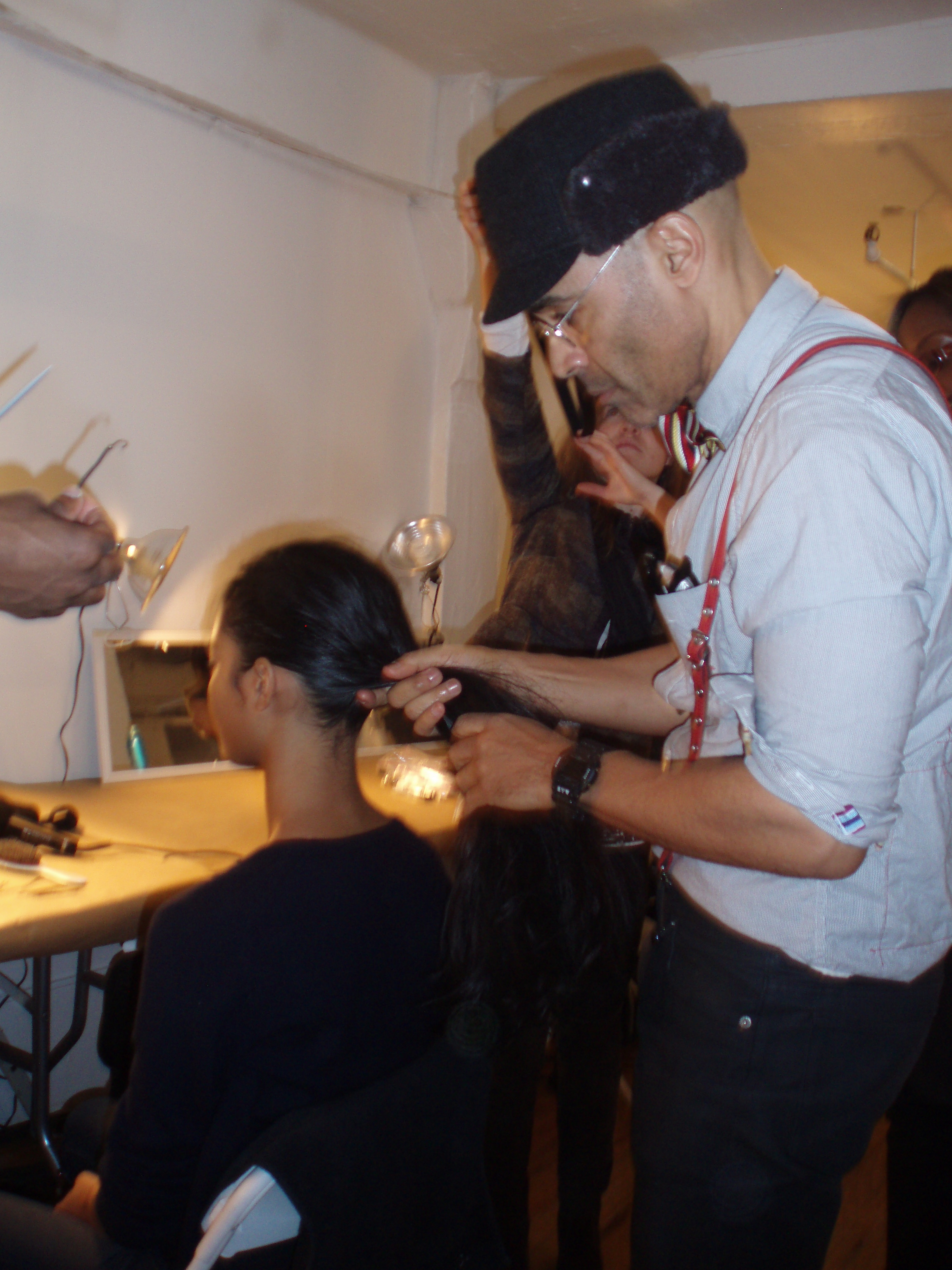Rolando Beauchamp for Bumble and bumble styles a ponytail.