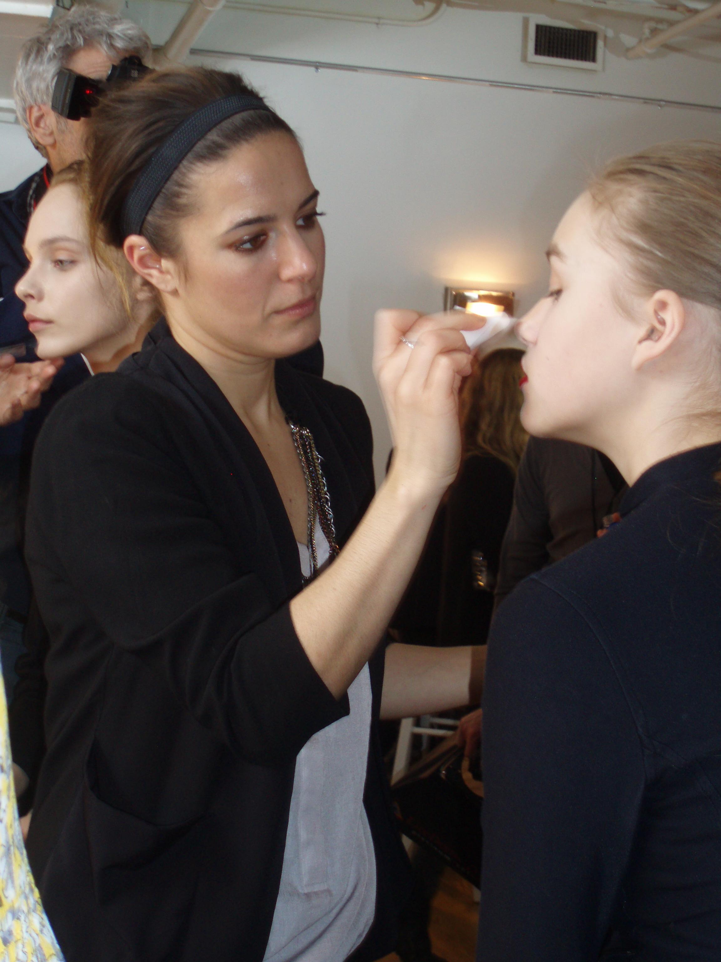 Jenna Menard for Shiseido applies minimal makeup and bright lips.