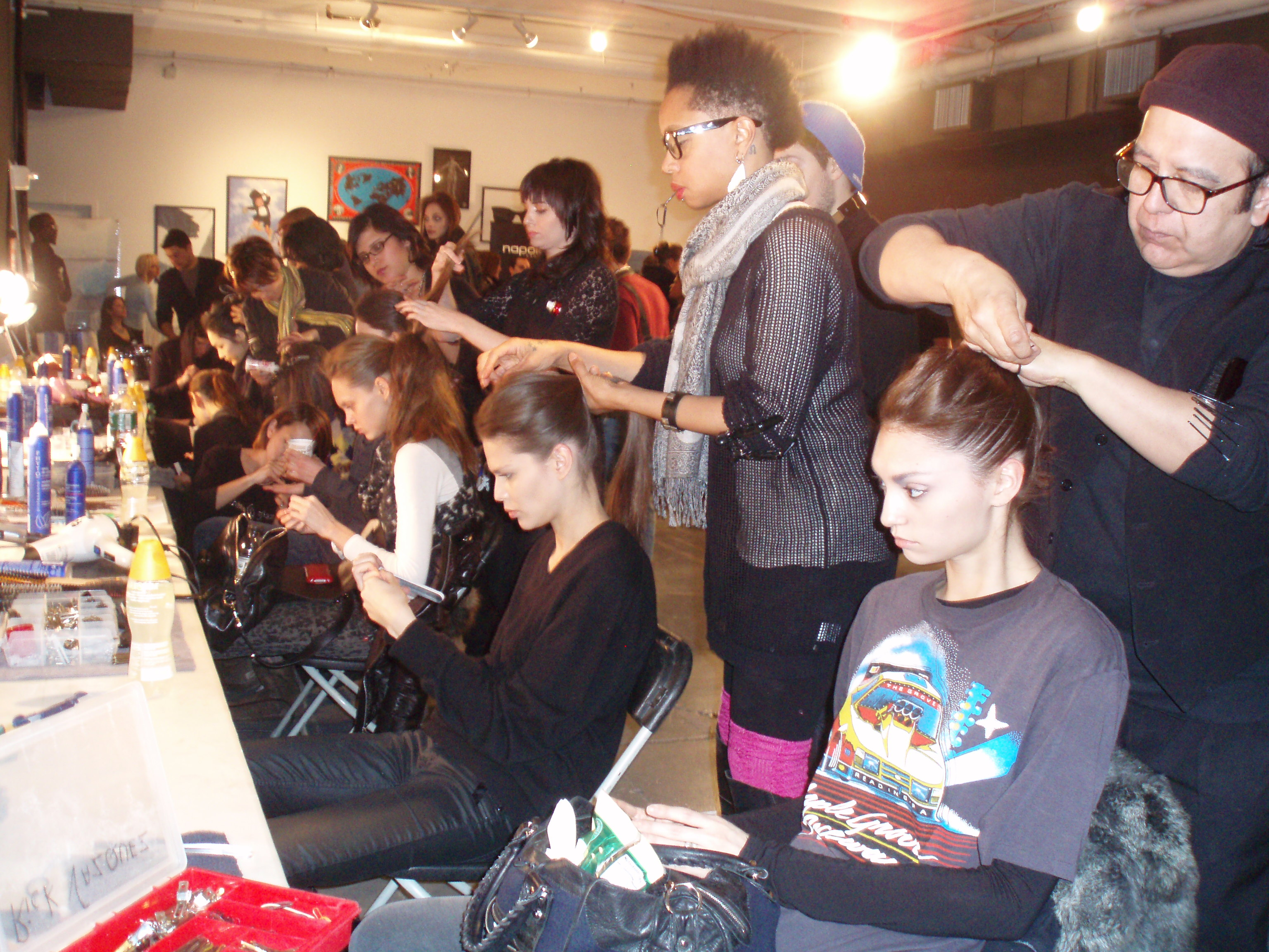 Stylists for Phyto work on messy chignon-like updos.