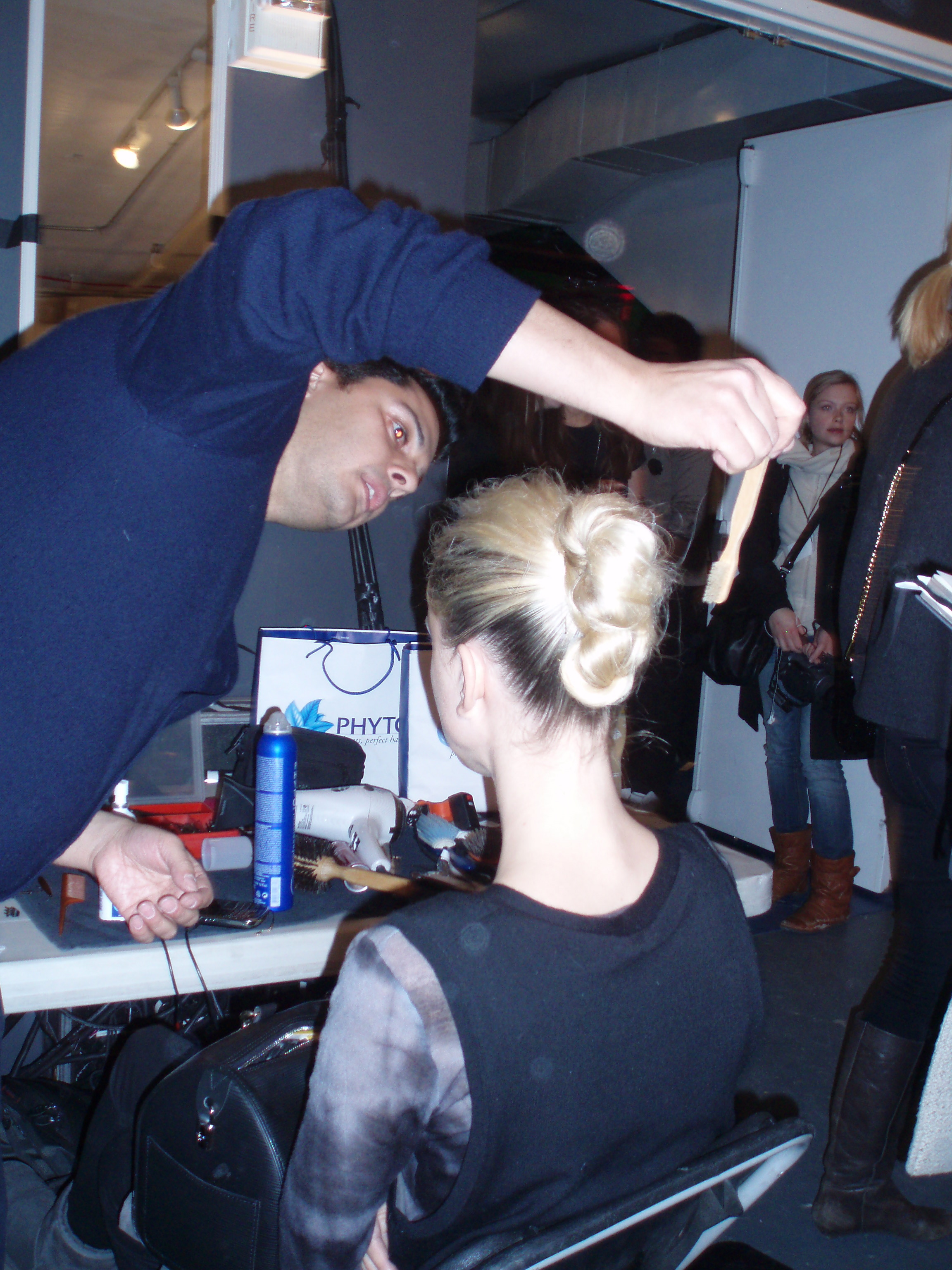 David Cruz for Phyto puts the finishing touches on an updo.