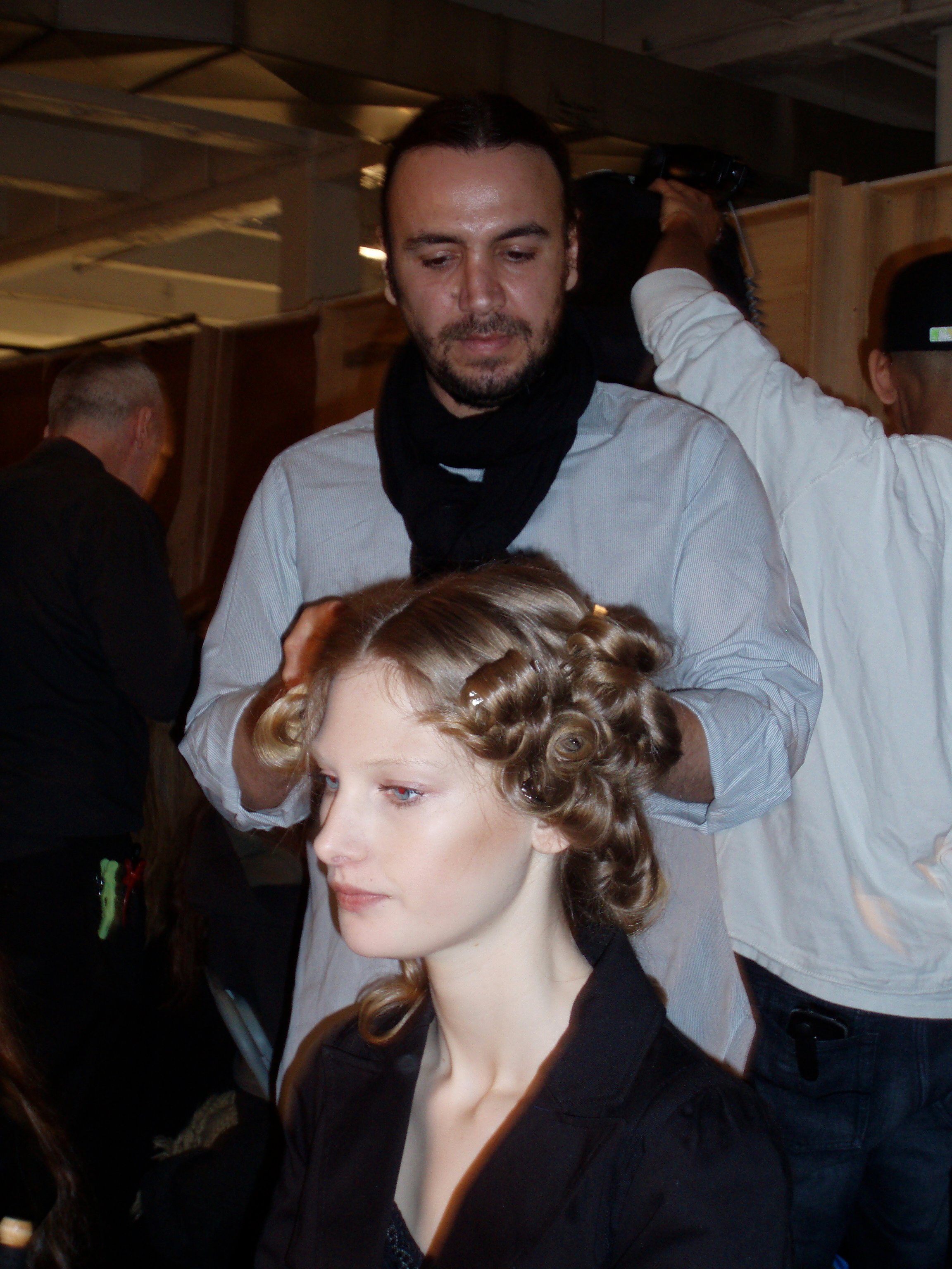 To create the curls, the stylists wrapped the hair around the barrel of a curling iron.