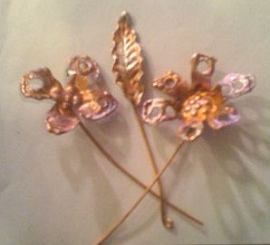 Rodarte designers Kate and Laura Mulleavy created these beautiful copper flowers for the hair