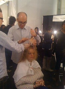 Jimmy Paul starting on a model's hair