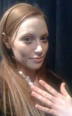 A model shows off her nails backstage