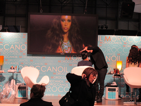 The Moroccanoil booth featured an exciting demonstration of how to recreate the looks from Moroccanoil's spring fashion week shows, including Baby Phat and Carolina Herrera.