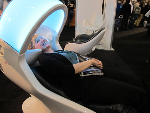 American Salon's Jamie Corkran checking out Gamma & Bross' luxurious Teknowash chair, which features iPod connectivity, a massaging back rest and reclining footrest and a soothing light display