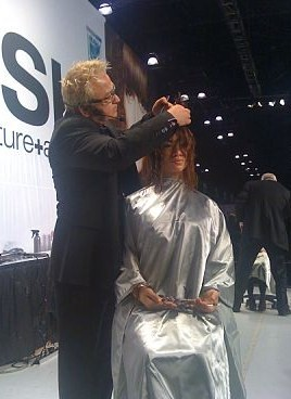 Boston salon owner Naz Kupelian styles hair on the Rusk stage
