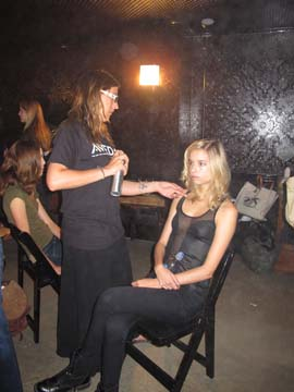 Jenn Chiminiello, lead stylist for Aveda, backstage at Organic by Jason Patrick