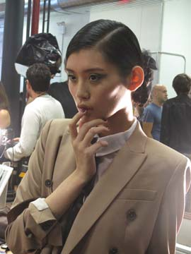 A model shows off CND's new Veronica shade from the Jason Wu capsule collection
