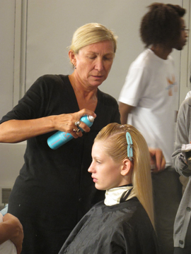 Odile Gilbert, lead stylist for Moroccanoil, backstage at Erin Fetherston
