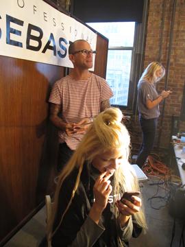 Thomas Dunkin, lead stylist for Sebastian Professional, backstage at Pamela Love
