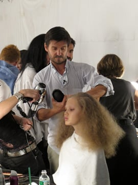 Guido, lead stylist for Redken, backstage at Marc Jacobs