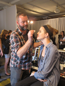 Dick Page, lead makeup artist for Shiseido, backstage at Reed Krakoff
