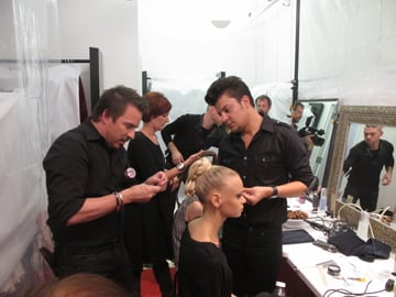 Lead hair and makeup stylist Ron King (left) backstage at Joanna Mastroianni