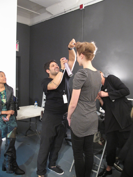 Lead stylist for L'Oréal Professionnel Amit Abraham backstage at Elene Cassis