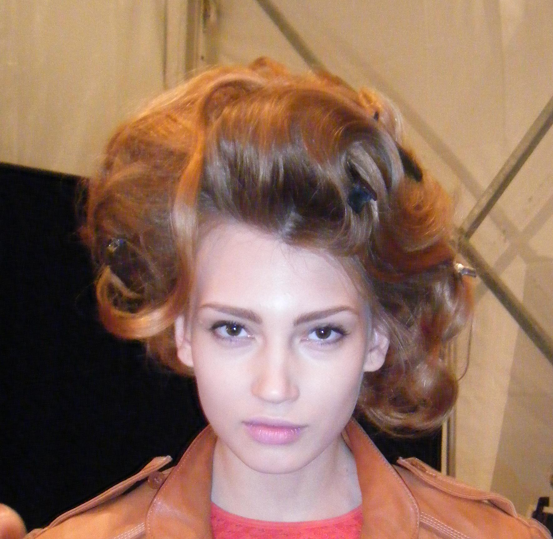 Finished wig on a model backstage.