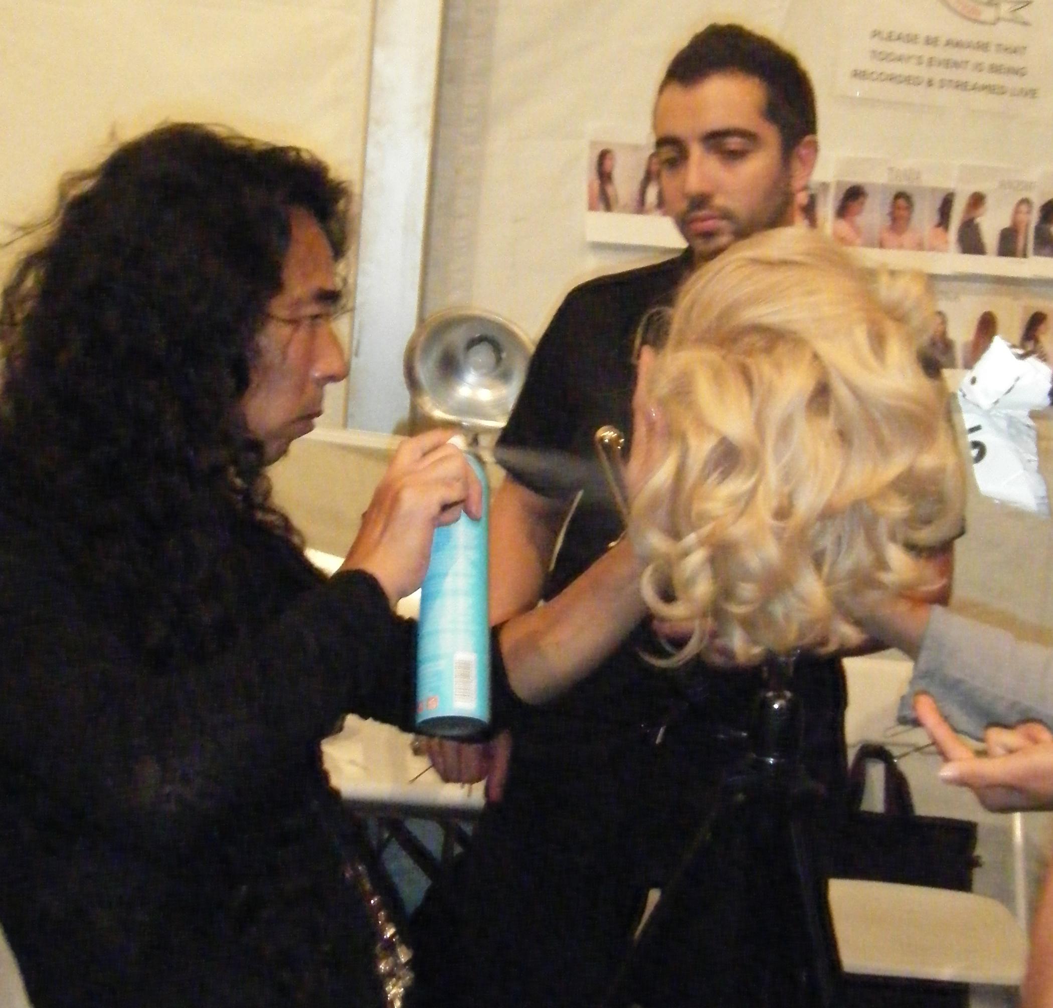 Yamane adding volume to a wig.