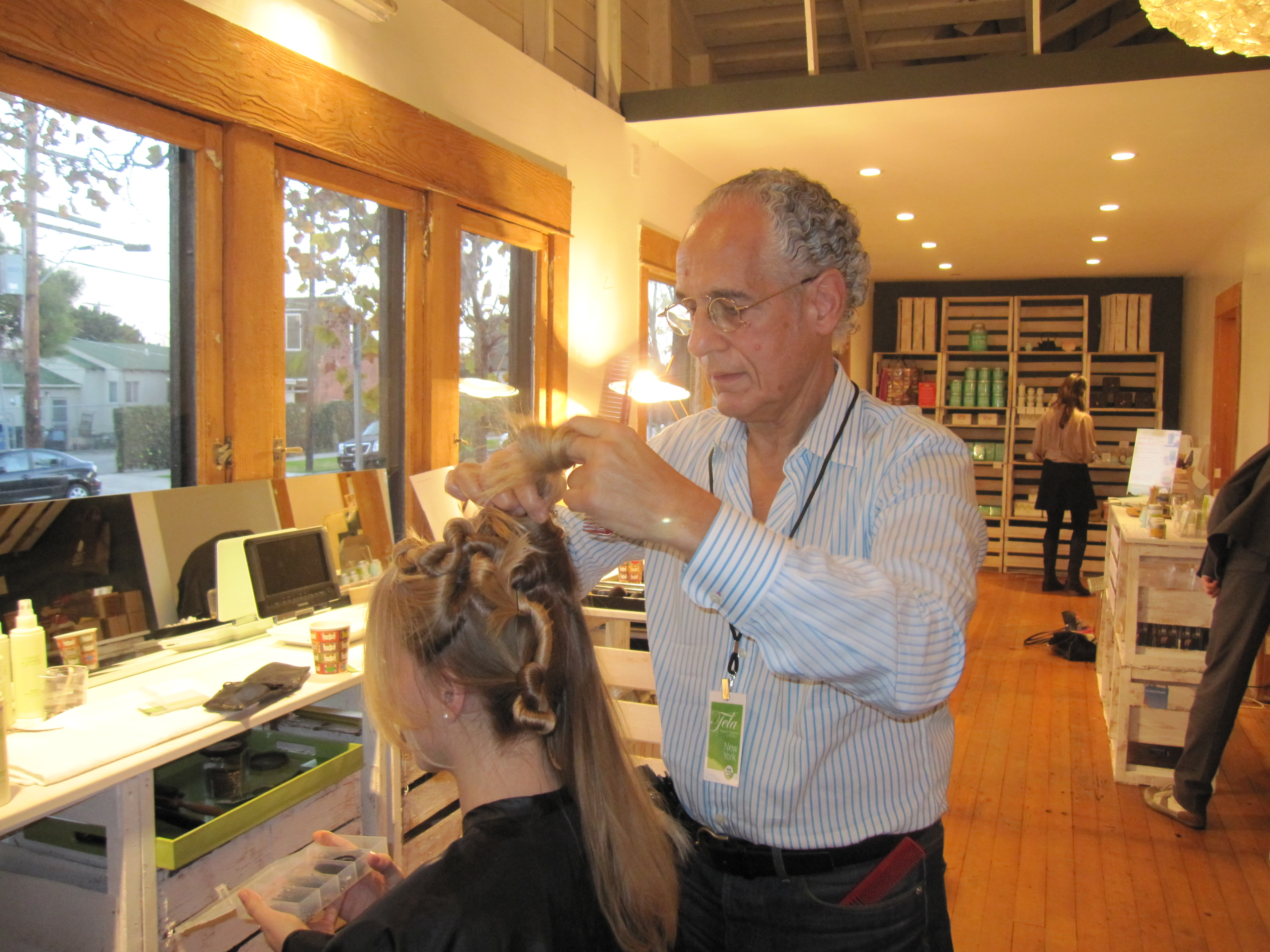 After applying Tela Beauty Organics Healer cream on Aubrey's sensitive hair, Philip Pelusi created four ponytails, which he twisted and pinned into place, to create loose waves.