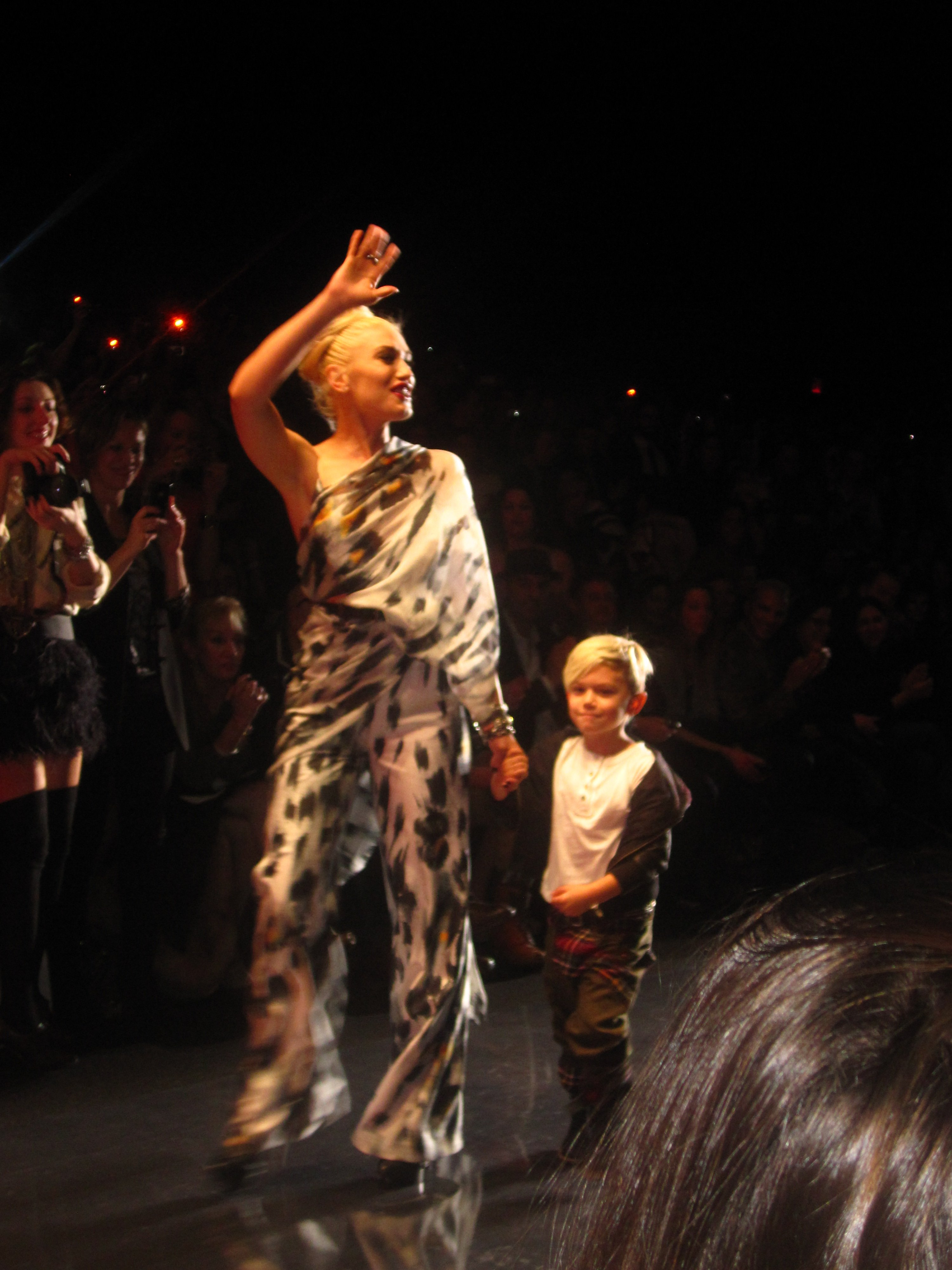Gwen and her son Kingston walk the runway