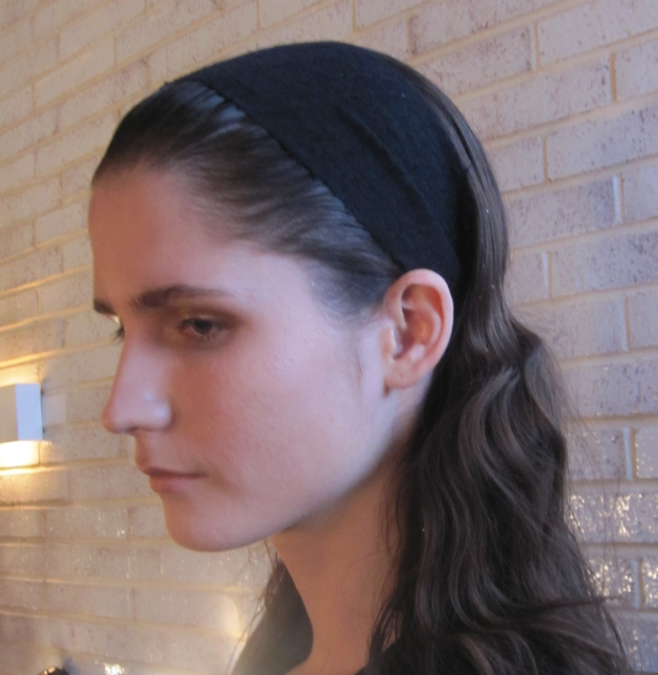 A hair net keeps the model's hair flat until showtime