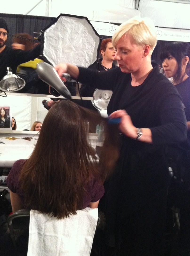 Antoinette Beenders preps a model