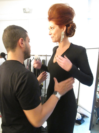 Fashion stylist Christopher Cambell fits our siren redhead model.