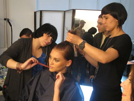 Stylist Josie Sanchez and her assistant restyle our cover model for an inside shot.