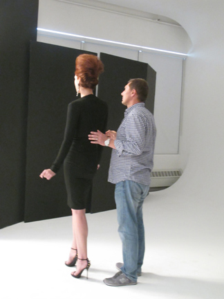 Darmon works with a model on set.
