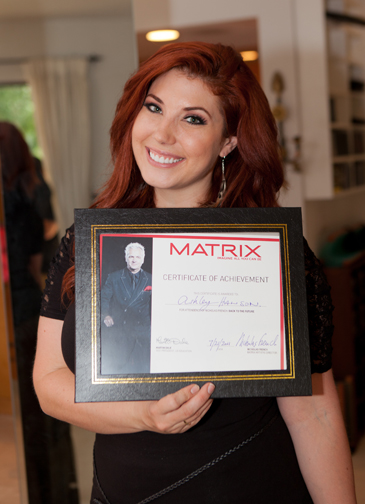Ashley shows off her diploma.