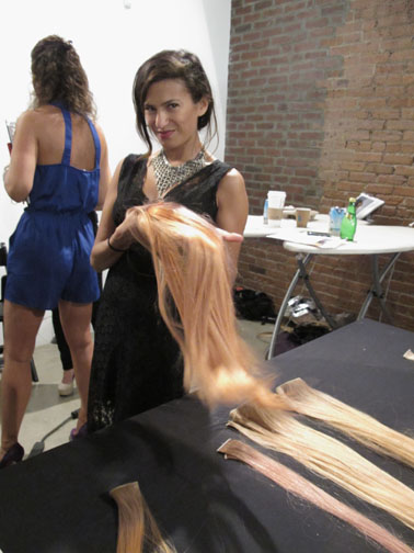 Aura Friedman shows off the wefts she colored for the show using Wella Professionals Color Touch and Relights.